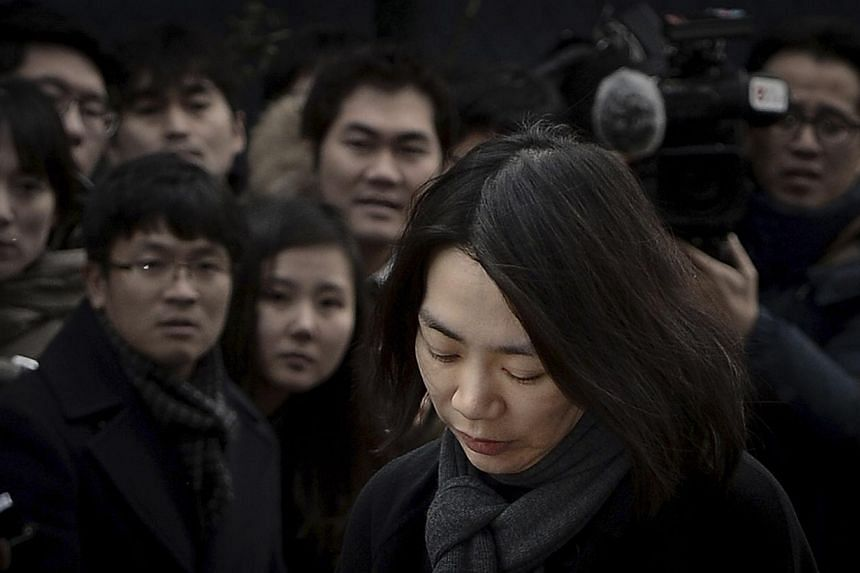 Cho Hyun Ah, also known as Heather Cho, daughter of chairman of Korean Air Lines, Cho Yang-ho, appears in front of the media outside the offices of the Aviation and Railway Accident Investigation Board of the Ministry of Land, Infrastructure, Transpo