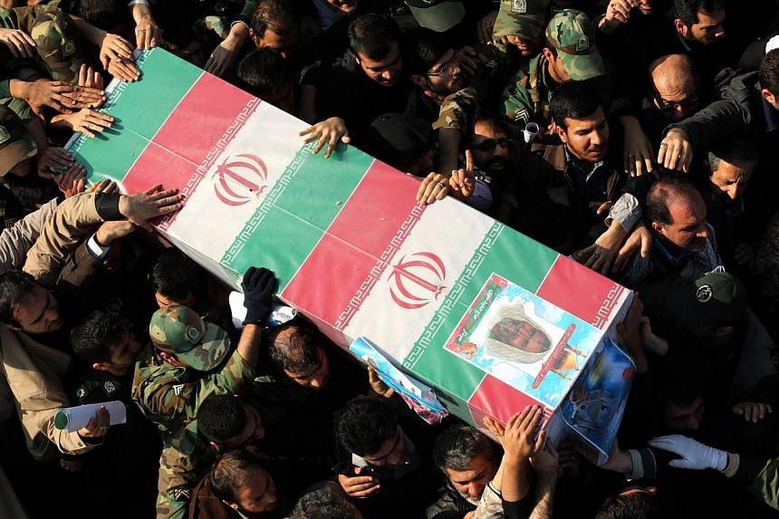 Iranians carry the coffin of Brigadier-General Hamid Taghavi, a commander of the Revolutionary Guards reportedly killed in the Iraqi city of Samarra, during his funeral in the capital Teheran on Dec 29, 2014.The Islamic State in Iraq and Syria