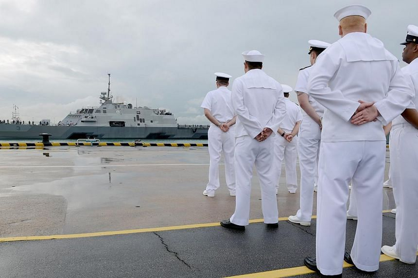 US Sailors watch as thelittoral combat ship USS Fort Worth (LCS 3) arrives in Singapore.-- PHOTO: UNITED STATES NAVY