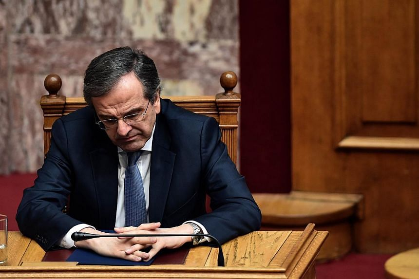 Greek Prime Minister Antonis Samaras attends the third round of a three-stage presidential election in the Greek parliament in Athens, on Dec 29, 2014.Greek lawmakers failed for a third time Monday to elect a new president, triggering a snap el