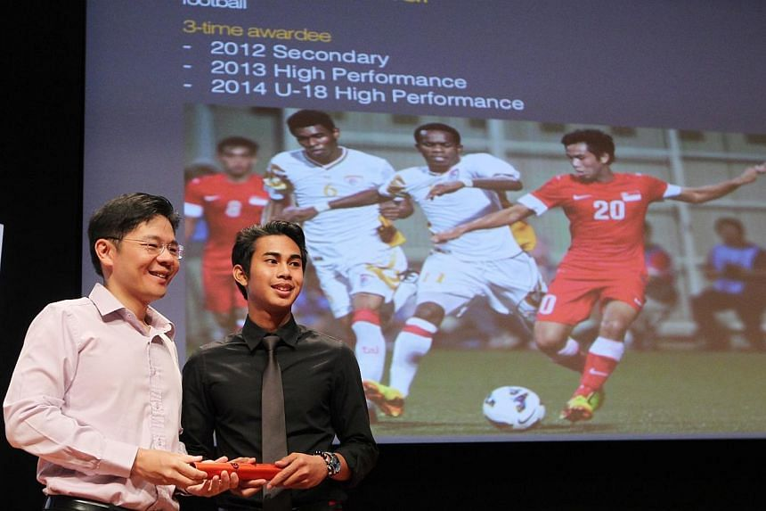 Minister for Culture, Community and Youth Lawrence Wong (left) posing with teenage national footballer Adam Swandi at Singapore Olympic Foundation-Peter Lim Scholarship Award ceremony held at the ITE College Central on July 5 2014.The scholarsh