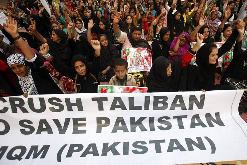 Protesters condemning the Taleban attack on the Army Public School in Peshawar, during a national solidarity rally in Karachi on Dec 19. The demonstration was led by the Muttahida Qaumi Movement (MQM), a political party whose supporters are firmly op