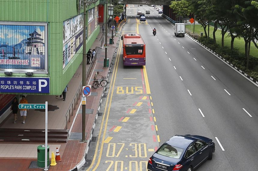 Additional road markings showing the operational hours of full-day bus lanes have been put up at seven locations, including Eu Tong Sen Street (above) and New Bridge Road. LTA said it will progressively extend the markings to all full-day bus lanes f