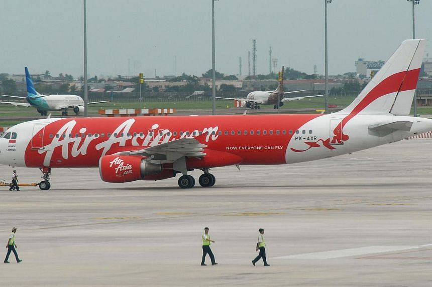 An AirAsia plane sits on the tarmac at Soekarno-Hatta airport in Tangerang near Jakarta on Dec 28, 2014.-- PHOTO: AFP