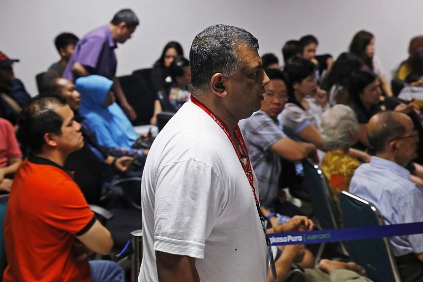 AirAsia CEO Tony Fernandes walks in front of family members of passengers onboard the missing AirAsia Flight QZ8501 at a news conference in Juanda International Airport, Surabaya on Dec 28, 2014.. -- PHOTO: REUTERS