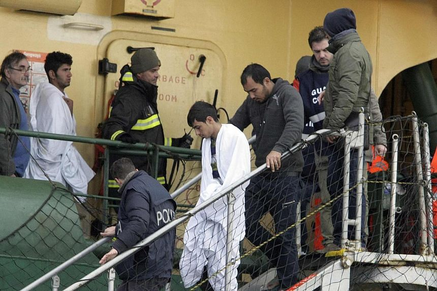 Passengers leaving the Spirit of Piraeus container ship as they arrive at Bari harbour after the car ferry Norman Atlantic caught fire in waters off Greece Dec 29, 2014. Rescuers announced the discovery of two more bodies, raising the death toll to s
