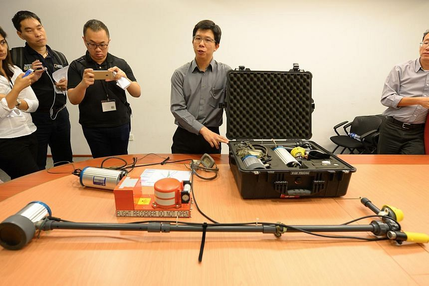 Senior investigator Steven Teo of the Air Accident Investigation Bureau of Singapore explaining to the media the functions of the various components of the Underwater Locater Beacon Detector System. Indonesia has accepted Singapore's offer of t