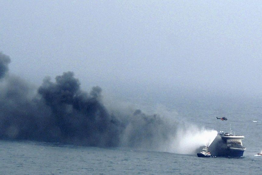 The car ferry Norman Atlantic burns in waters off Greece on Dec 28, 2014 in this handout photo provided by Marina Militare. -- PHOTO: REUTERS