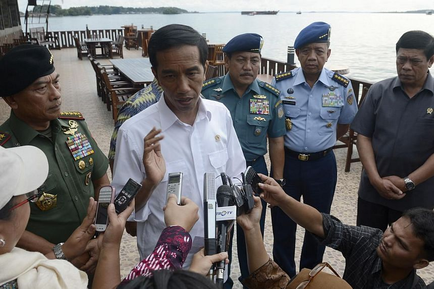 Indonesian President Joko Widodo (centre), accompanied by (left to right) military commanders General Moeldoko, Navy Chief Admiral Marsetio, Air Chief Marshal Ida Bagus Putu Dunia and Coordinating Political, Legal and Security Affairs Minister Tedjo