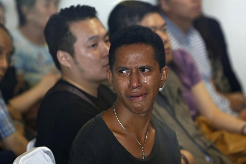 A family member of a passenger onboard the missing AirAsia flight QZ8501 cries as he awaits news of the plane at a waiting area in Juanda International Airport, Surabaya on Dec 29, 2014. -- PHOTO: REUTERS