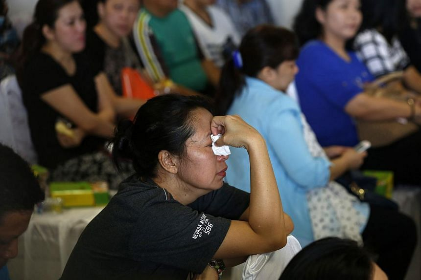 Family members of passengers onboard the missing AirAsia flight QZ8501 waiting news in Juanda International Airport, Surabaya on Dec 29, 2014. -- PHOTO: REUTERS