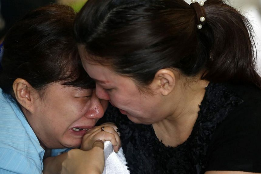 Family members of passengers onboard missing AirAsia flight QZ8501 cry at a waiting area in Juanda International Airport, Surabaya on Dec 29, 2014. -- PHOTO: REUTERS