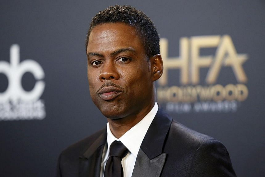 Actor Chris Rock poses backstage with his comedy film award for Top Five during the Hollywood Film Awards in Hollywood, California on November 14, 2014. -- REUTERS