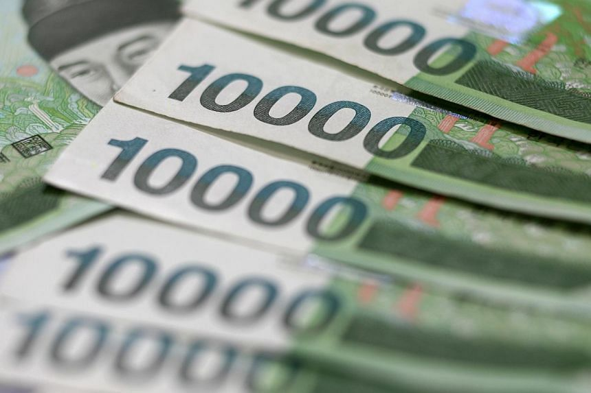 South Korea 10,000 won notes are arranged for a photograph in Seoul, South Korea, on Monday, Aug 8, 2011.-- PHOTO: BLOOMBERG