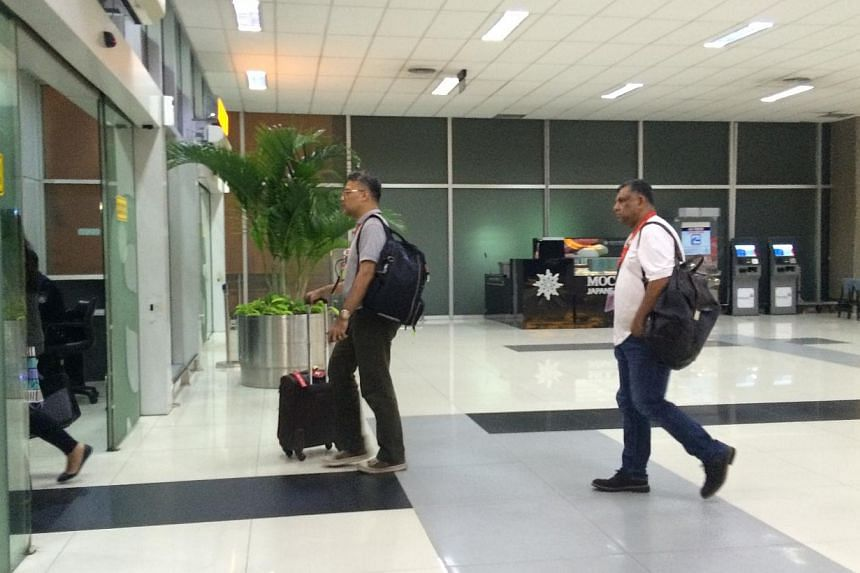 AirAsia CEO Tony Fernandez (right) seen arriving at Soekarno-Hatta Airport Terminal 3 in Jakarta at about 1.30am on Dec 29, 2014. -- ST PHOTO: KEVIN LIM