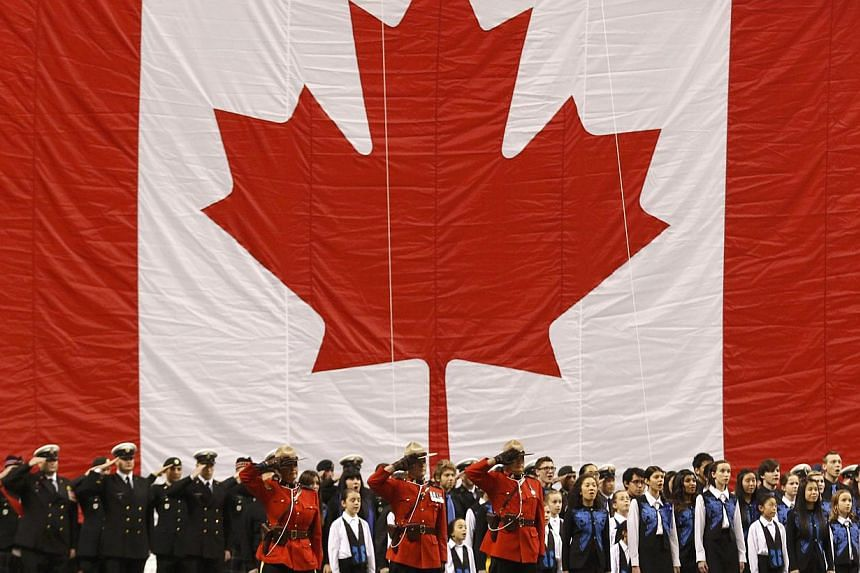 Members of the military and of the Royal Canadian Mounted Police joining children in ceremonies before the start of Canada's 102nd Grey Cup football championship in Vancouver, British Columbia, on Nov 30, 2014.Immigrant children raised in an en