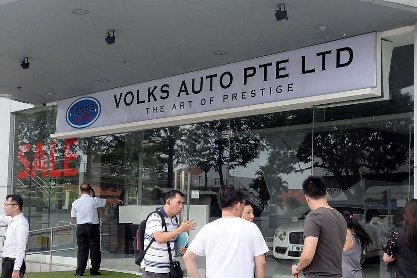 Mr K.K. Lo (above) suggests that consumers pay the $10,000 certificate of entitlement bidding deposit directly to the Land Transport Authority instead of through dealerships. Volks Auto (above, right) shut its doors more than two weeks ago after coll