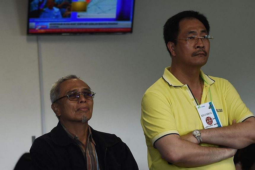 Family members of passengers on the missing plane react to news that floating debris was spotted on Dec 30, 2014. -- PHOTO: AFP