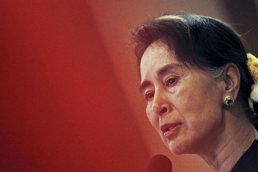 Myanmar's opposition leader Aung San Suu Kyi speaks at the National League for Democracy Party's central comity meeting at a restaurant in Yangon on Dec 13, 2014. - PHOTO: REUTERS