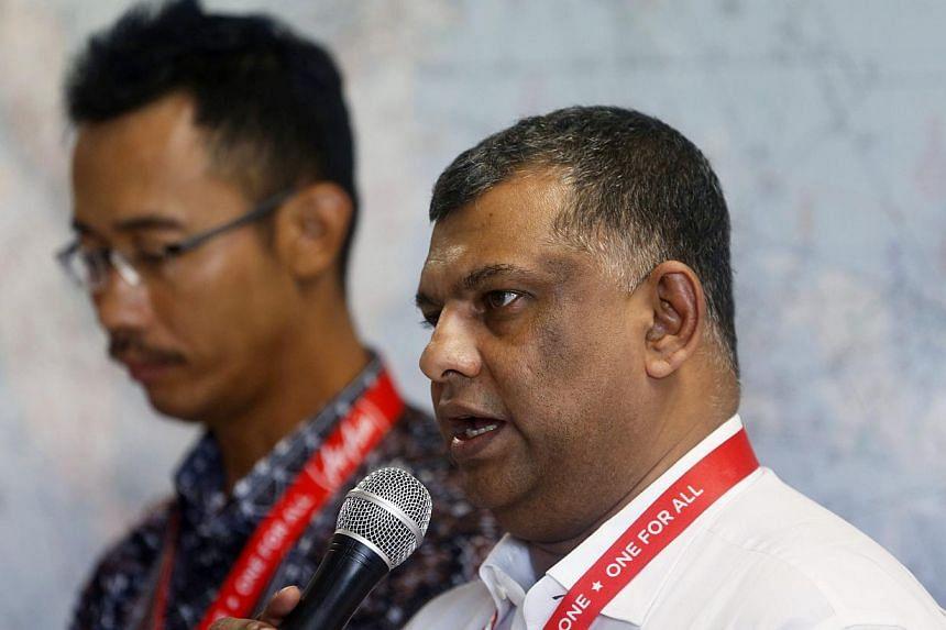 AirAsia CEO Tony Fernandes (right) talking to the family members of passengers onboard AirAsia flight QZ8501 at Surabaya's Juanda International Airport on Dec 29, 2014. -- PHOTO: REUTERS