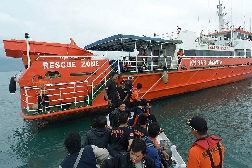 Members of an Indonesian search and rescue team preparing to set off to search at sea for missing AirAsia flight QZ8501 from Manggar in East Belitung on Dec 30, 2014. -- PHOTO: AFP