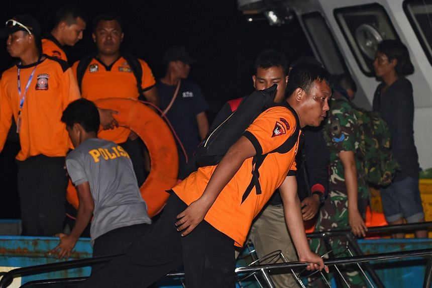 Members of an Indonesian search and rescue team returning to the port in Manggar on East Belitung island on Dec 29, 2014 as the international effort to search for missing AirAsia flight QZ8501 continues. -- PHOTO: AFP