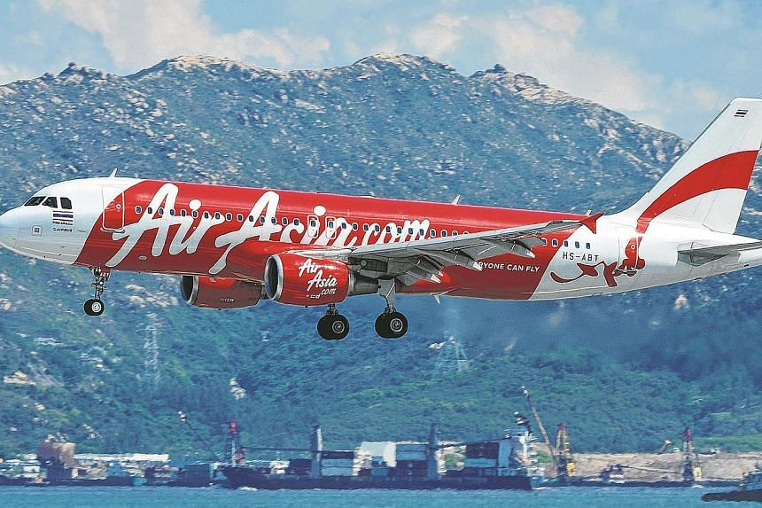 """An AirAsia flight bound for north-east Thailand turned back to the capital Bangkok shortly after takeoff on Tuesday when pilots detected an """"irregularity"""" in the storage compartment, airline officials said. -- PHOTO: AFP"""
