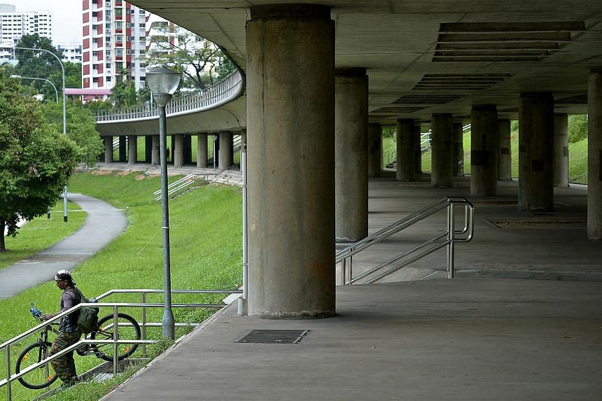 A cyclist under the MRT track on the north-south line near block 420, Ang Mo Kio Avenue 10, the section between Bishan and Ang Mo Kio MRT stations. -- ST PHOTO: KUA CHEE SIONG