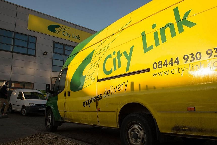 A City Link van parked outside a parcel delivery depot in south London on Dec 29, 2014. More than 2,000 workers at the British parcel delivery firm were told on Christmas Day that they would lose their jobs. -- PHOTO: AFP