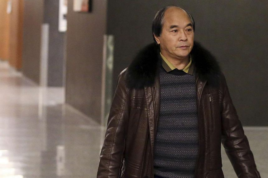"""Murder victim Lin Jun's father, Mr Lin Diran, attending the closing arguments of the Luka Rocco Magnotta trial in Montreal, Dec 11, 2014. He described Magnotta, in comments on Monday, as""""worse than a beast"""". -- PHOTO: REUTERS"""