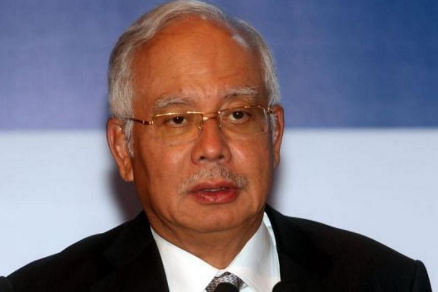 """Malaysian Prime Minister Najib Razak extended his """"heartfelt condolences"""" to families and loved ones of victims aboard the Indonesia AirAsia flight QZ8501,which went missing over Indonesian waters on Dec 28, 2014. -- PHOTO: THE STAR/ASIA NEWS N"""