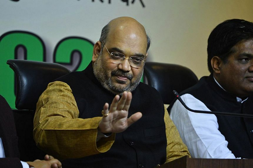 Amit Shah (centre), the head of India's ruling Bharatiya Janata Partyand the closest aide of Indian Prime Minister Narendra Modi, was acquitted of three murder charges on Tuesday, Dec 30,2014, in a trial that had undermined the government's pro