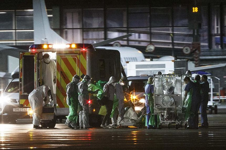 An Ebola patient is transferred onto a Hercules transport plane at Glasgow Airport in Scotland, to be sent to London, on Dec 30, 2014. A second health worker is being tested for Ebola in Scotland after returning from West Africa, a day after another