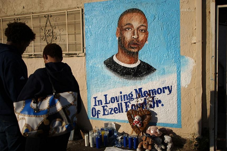 A mural of Ezell Ford at the site where he was shot and killed in August. -- PHOTO: AFP