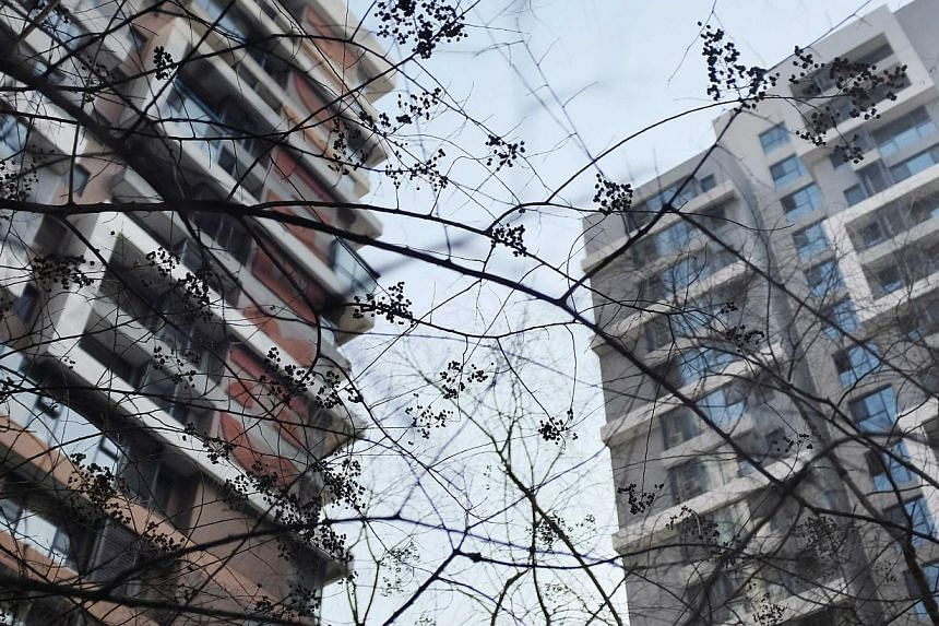 Apartment blocks in Beijing. A property developer in China reportedly hired a group of people with HIV to harass residents into leaving their homes. -- PHOTO: REUTERS
