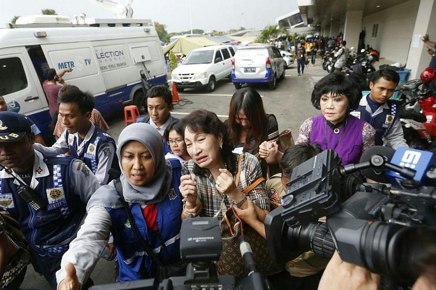 Family members at the crisis centre at Juanda International Airport Terminal 2 in Surabaya on Dec 30, 2014. -- ST PHOTO: KEVIN LIM