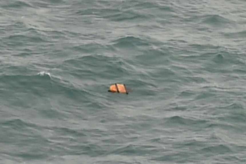 Debris spotted on Tuesday during an aerial search for AirAsia flight QZ8501 is from the missing plane, Indonesia's director general of civil aviation told AFP.-- PHOTO: AFP