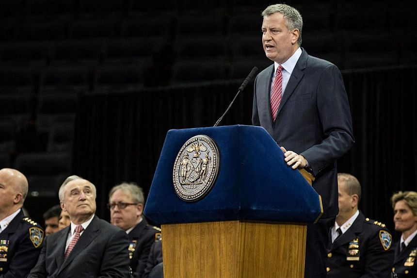 New York City Mayor Bill de Blasio speaks at the New York Police Department graduation ceremony at Madison Square Garden on Dec 29, 2014 in New York City. The mayor's relationship with the city's police force has been strained recently after the deat