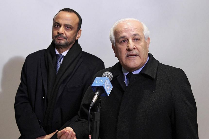 Riyad H. Mansour (right), Permanent Observer of the State of Palestine to the UN, and Sidi Mohamed Ould Boubacar, Permanent Representative of the Islamic Republic of Mauritania to the UN, in New York on Dec 30, 2014, following a meeting of Arab deleg