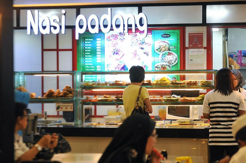 The food stall in Northpoint shopping centre was inspected and found to have hygiene lapses, and the stallholder was prosecuted and fined under the Environmental Public Health (Food Hygiene) Regulations. -- PHOTO: ST FILE