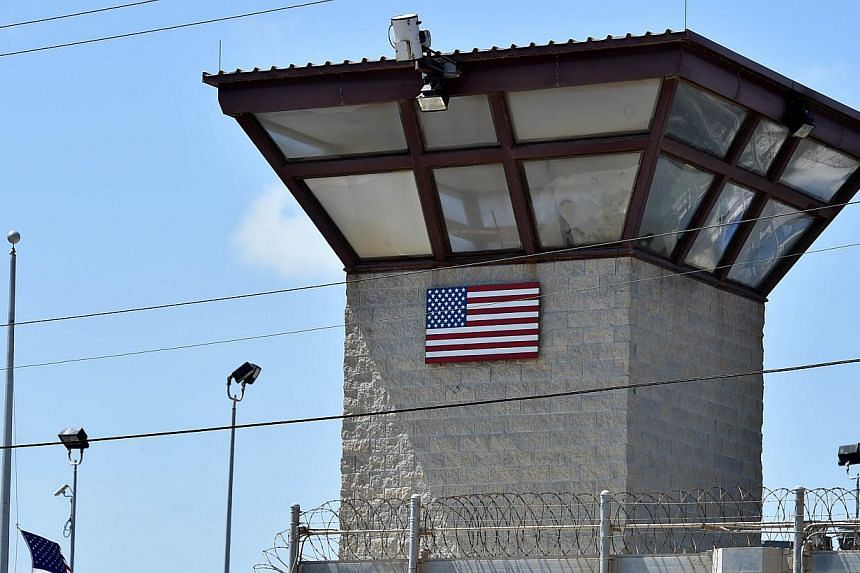 An April 8, 2014 photo shows the Camp 6 detention facility at the US Naval Station in Guantanamo Bay, Cuba. Three Yemenis and two Tunisians held for more than a decade at the military prison have been flown to Kazakhstan for resettlement. -- PHOTO: A