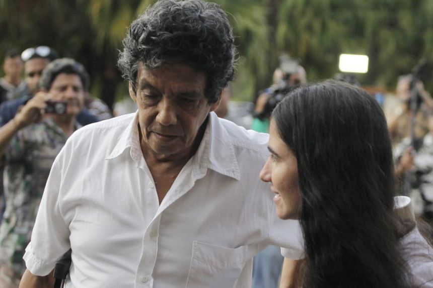 Prominent Cuban dissident and blogger Yoani Sanchez (right) walks with her husband Reinaldo Escobar outside Havana's Jose Marti International Airport in this May 30, 2013 file photo. Mr Escobar was one of several activists detained by the Cuban gover