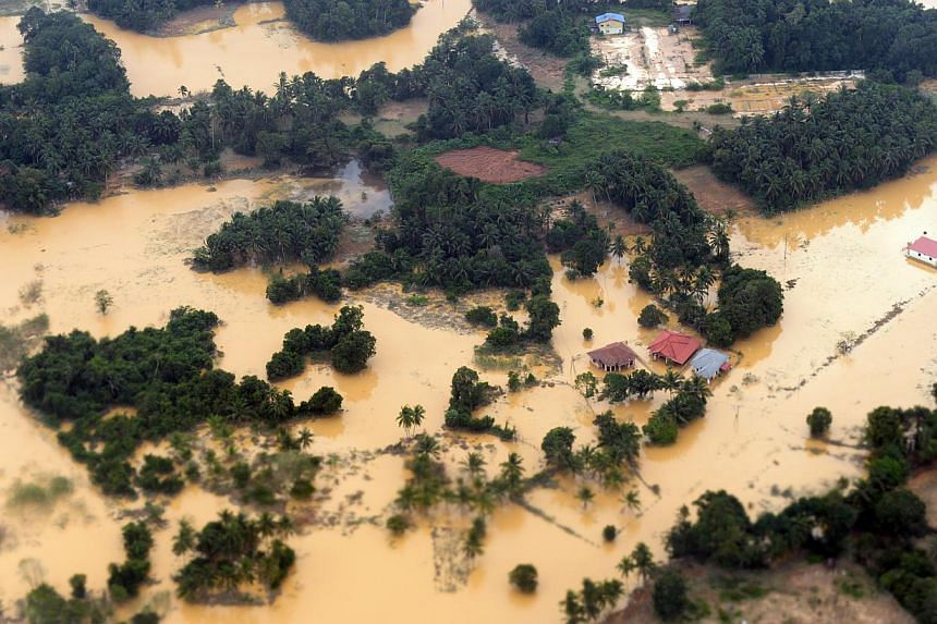 One of the badly hit areas in Kelantan, where rain has abated after heavy flooding in the past fortnight. Tens of thousands of people have been driven to shelters, where they remain amid fears of new floods. Many residents are not taking any chances