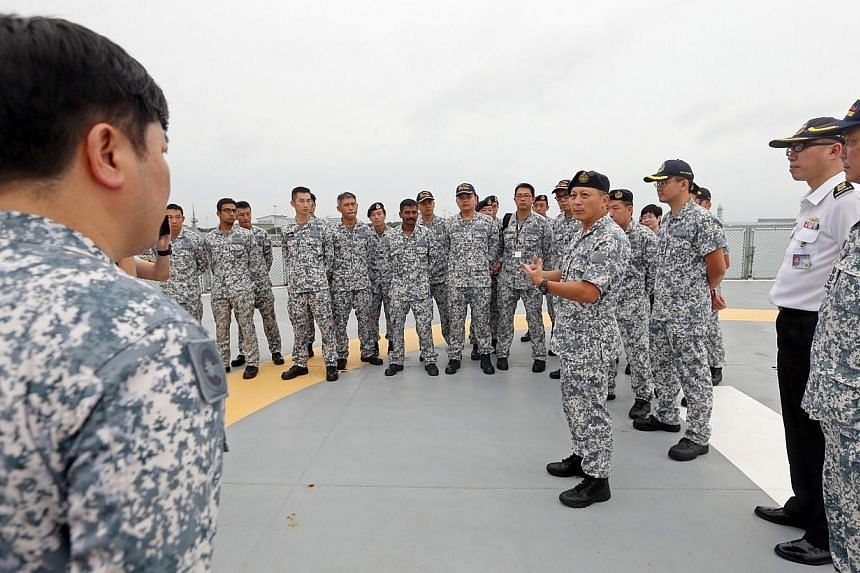 (Fourth from right) Rear Admiral Jackson Chia (Chief of Staff, Naval Staff) speaks to navy personnel of MV Swift Rescue before the ship departs. MV Swift Rescue is the fourth ship to be sent by Singapore to help in the search for QZ8501 departs from