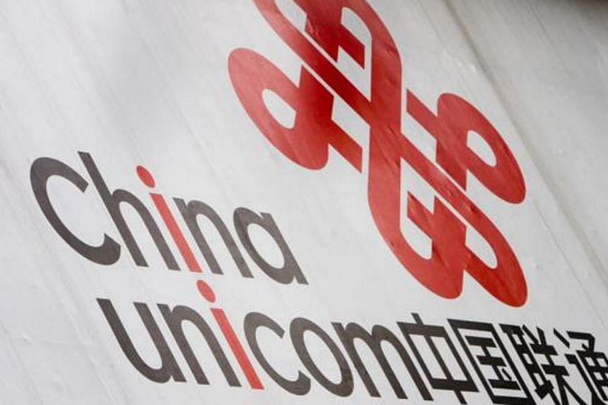 A sign for China Unicom marks the entrance to one of the companies's stores, in Guangzhou, China -- PHOTO: BLOOMBERG