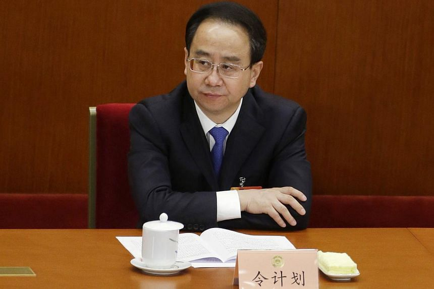Mr Ling Jihua, a senior Chinese Communist Party official who was a close aide to former president Hu Jintao, has been removed from his post amid a corruption investigation, state media said on Wednesday. -- PHOTO: REUTERS