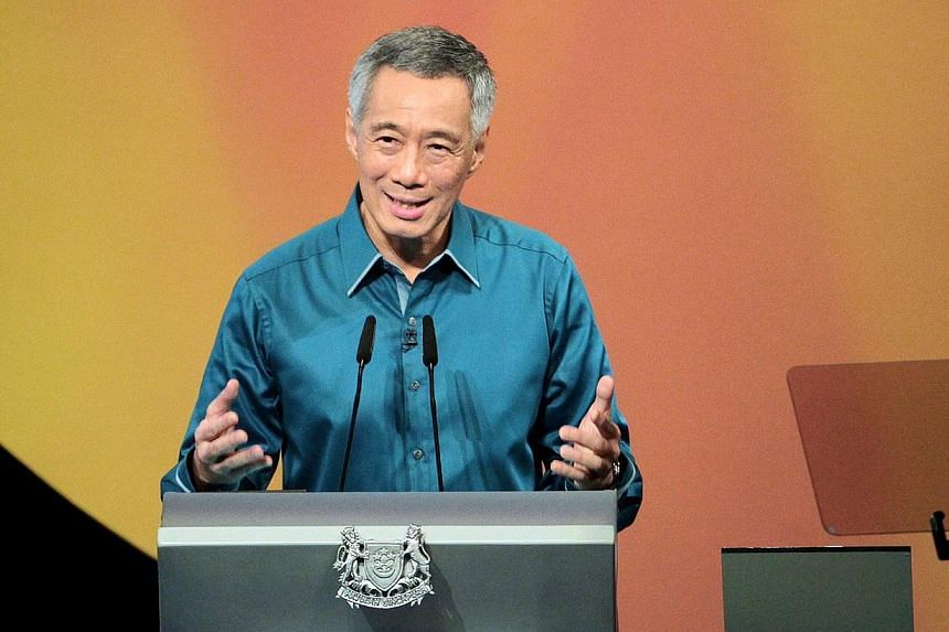 """The economy grew a """"moderate"""" 2.8 per cent in 2014 as productivity gains remained weak for a third straight year, Prime Minister Lee Hsien Loong said in his yearly New Year message on Wednesday, Dec 31, 2014, but added that incomes continued to rise."""