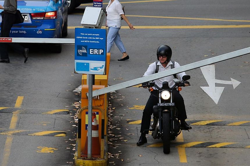 A new season parking ticket for motorcycles, which will allow short-term parking at most HDB and URA car parks for a flat monthly fee of $20, will be available for use from Jan 1, 2015. -- ST FILE PHOTO