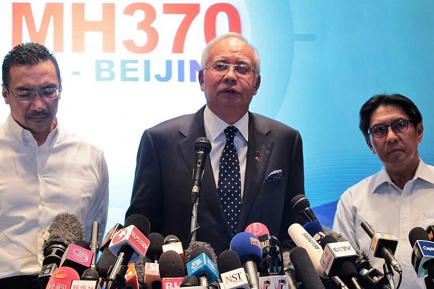 Malaysian Prime Minister Najib Razak (centre), flanked by Defence and then Acting Transport Minister Hishammuddin Hussein (left) and Civil Aviation chief Azharuddin Abdul Rahman at the media briefing of the missing Malaysia Airlines Flight MH370 on M