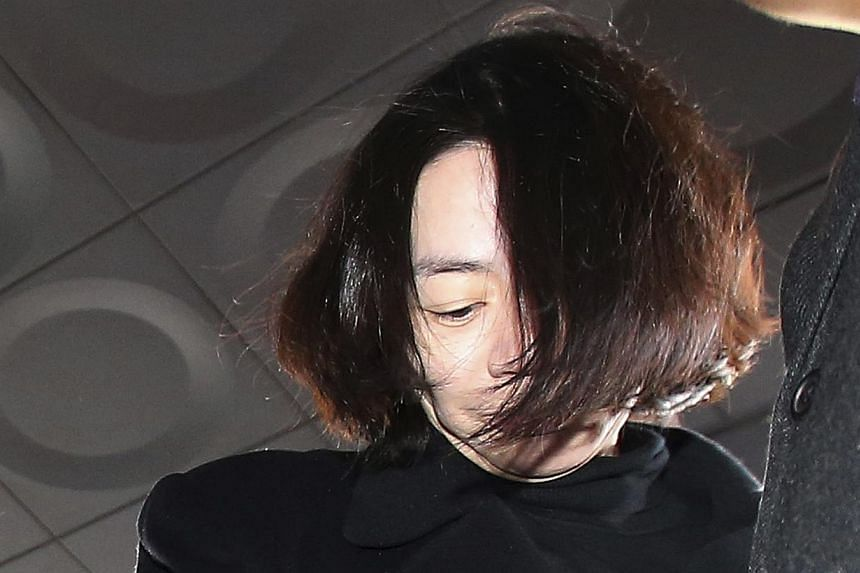 "The second daughter of Korean Air's chief executive apologised Wednesday for swearing ""revenge"" in a text message to her sister Heather Cho Hyun Ah (pictured), who has been arrested for delaying a flight with a tantrum over snacks. -- PHOTO: REUTERS&"